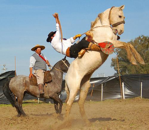 Man riding a bucking horse