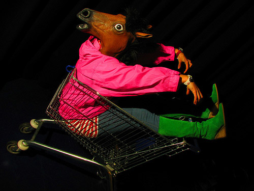 Woman in horse costume in shopping cart