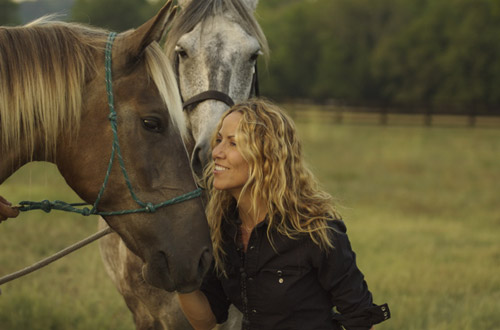 Sheryl Crow on horseback