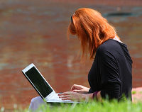 Woman on a laptop outside
